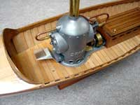 steam engine on wooden boat